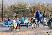 Israel, Near Eilat, Thai migrant workers on the way to the fields. IsraelI farmers rely heavily on migrant workers for all the manual work in the field. The biggest source of agriculture workers is Thailand. These workers are sometimes kept in very poor conditions