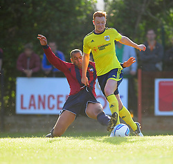 Bristol City's Ryan Taylor is challenged for the ball - Photo mandatory by-line: Dougie Allward/JMP - Tel: Mobile: 07966 386802 03/07/2013 - SPORT - FOOTBALL - Bristol -  Ashton and Backwell United V Bristol City - Pre Season Friendly