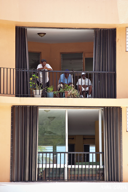 Residents watch the carnival from their balcony.  Mini Carnival at Lucinda Millin Home for the Aged.  St. Thomas, USVI.  11 April 2015.  © Aisha-Zakiya Boyd