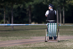 © Licensed to London News Pictures. 12/08/2016. London, UK. A police officer guards a cordon in Hyde Park after a body was found this morning. Photo credit: Peter Macdiarmid/LNP