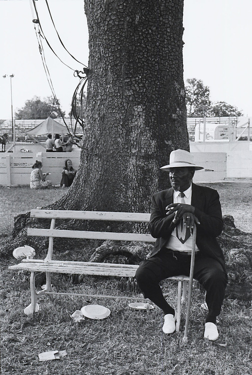 Man rests at the New Orleans Fairgrounds during the third Louisiana Jazz and Heritage festival in New Orleans in 1972s