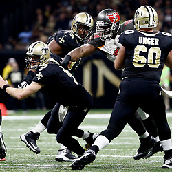 Dec 24, 2016; New Orleans, LA, USA; New Orleans Saints quarterback Drew Brees (9) escapes from Tampa Bay Buccaneers defensive tackle Clinton McDonald (98) during the second quarter of a game at the Mercedes-Benz Superdome. Mandatory Credit: Derick E. Hingle-USA TODAY Sports