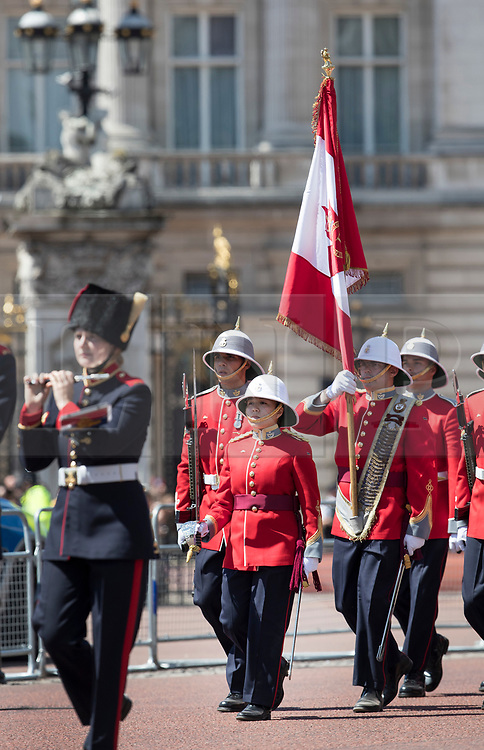 © Licensed to London News Pictures. 26/06/2017. London, UK. Captain Megan Couto (C) of the 2nd Battalion, Princess Patricia's Canadian Light Infantry becomes the first woman to command the Queen's Guard as she marches from Buckingham Palace. The Canadian Light Infantry are taking part in the Changing of the Guard Ceremony as part of the 150th anniversary of the founding of the nation of Canada. Photo credit: Peter Macdiarmid/LNP