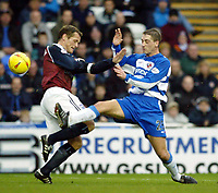 Photgraph: Scott Heavey.<br /> Reading v Ipswich Town. Nationwide Division One. 10/01/2004.<br /> Ricky Newman gets a toe ahead of Jim Magilton (L)