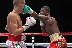 June 18, 2011; Guadalajara, Jalisco; MEX; Adrien Broner (red trunks) and Jason Litzau (white trunks) during their 12 round bout in Guadalajara, Mexico.  Broner won via 1st round KO.  Photo: Ed Mulholland/HBO