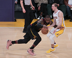 March 11, 2018 - Los Angeles, California, U.S - LeBron James #23 of the Cleveland Cavaliers drives against Alex Caruso #4 of the Los Angeles Lakers during their NBA game on Sunday March 11, 2018 at the Staples Center in Los Angeles, California. Lakers defeat Cavaliers, 127-113. (Credit Image: © Prensa Internacional via ZUMA Wire)