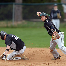 Staff photos by Tom Kelly IV<br /> Ridley shortstop Jake Hoffman (27) tries to turn the double play but throws the ball away giving the batter second base.  Strath Haven's Evan Atsaves (22) was out at second on the play during the Ridley at Strath Haven baseball game on Thursday afternoon.