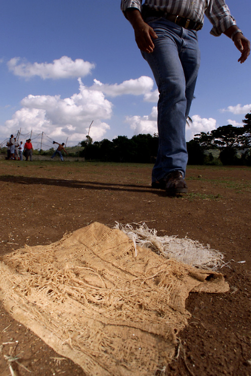 024214.SP.0114.ramon8.kc--COTUI, Dominican Republic--An old tattered bag serves as second base on the baseball field where Anaheim Angel pitcher Ramon Ortiz was discovered.