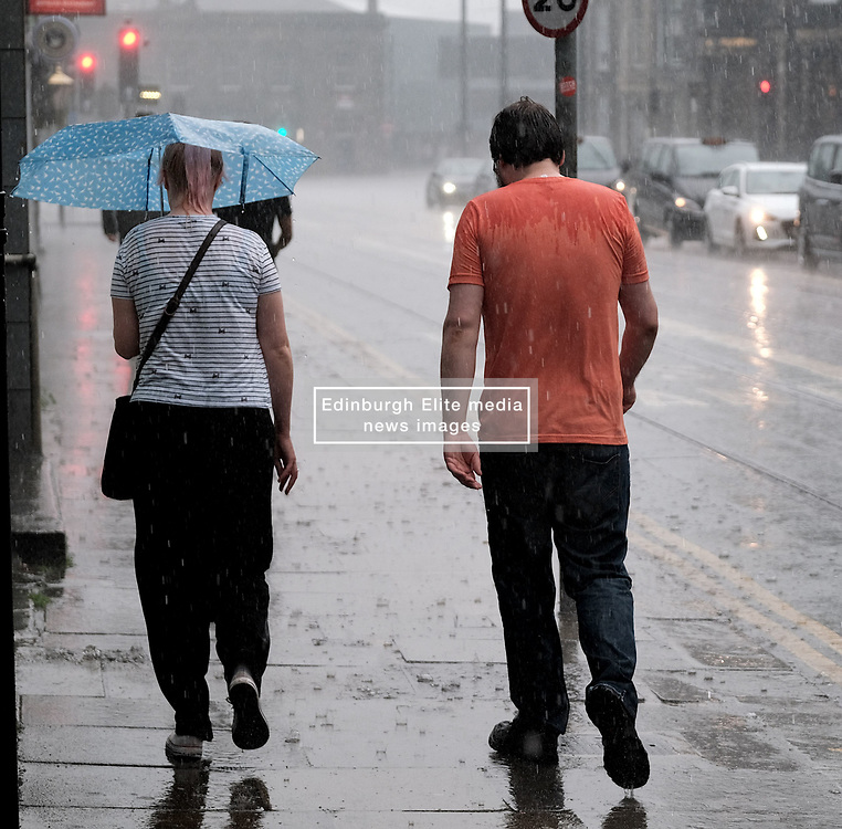 After the really hot weather, Edinburgh was hit by a thundestorm this evening<br /> <br /> Pictured: People in Haymarket hurry to escape the rain<br /> <br /> Alex Todd   Edinburgh Elite media