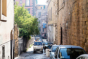 narrow street scene in the Rione Sanità neighborhood of Naples Italy