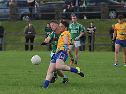 Achill&rsquo;s             tries to get the block on Knockmore&rsquo;s              during the junior champonship match in Achill on saturday evening.<br /> Pic Conor McKeown
