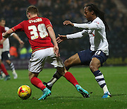 Daniel Johnson and Ben Osborn battle during the Sky Bet Championship match between Preston North End and Nottingham Forest at Deepdale, Preston, England on 3 November 2015. Photo by Pete Burns.