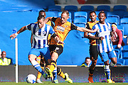 Brighton striker Tomer Hemed holds off a challenge from Hull City midfielder David Meyler during the Sky Bet Championship match between Brighton and Hove Albion and Hull City at the American Express Community Stadium, Brighton and Hove, England on 12 September 2015. Photo by Bennett Dean.