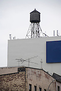 water storage tower and antennas on top of a roof in New York City