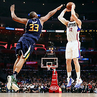 25 March 2016: LA Clippers forward Blake Griffin (32) takes a jump shot over Utah Jazz center Boris Diaw (33) during the Los Angeles Clippers 108-95 victory over the Utah Jazz, at the Staples Center, Los Angeles, California, USA.