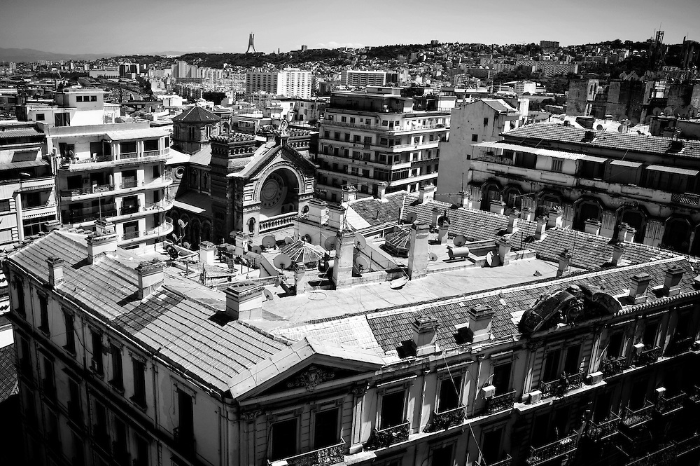 Algiers May 2012. A view from Youbi's apartment on Didouche Mourad street. From the terrace it is visible  the old San Charles church, now a mosque. The Champ-de-Manuvres neighbourhood and the Martyrs monument (Makham Ech Chaid)  on the top of the hill.