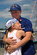 New London, Connecticut, USA - July 9, 2012: Nine-year-old Amelia Baca greets her sister, United States Coast Guard 3rd Class Cadet Micaela Baca, at the pier at Fort Trumbull where the Coast Guard Barque Eagle, on which Cadet Baca has been training, is moored for the balance of OpSail 2012 CT which ends today with the various ships sailing back to their home ports. The Eagle's homeport is New London, Connecticut. Amelia, a triplet, came with her mother and two triplet brothers from their home in Lexington, Virginia to visit their sister the cadet.