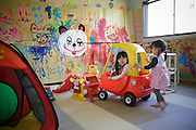 A warehouse that doubles up as an indoor playground for children due to the high levels of radiation outdoors and a food distribution centre for residents who fear eating the local produce and drinking the tap water. Minamisoma, Fuksushima Prefecture, Japan.