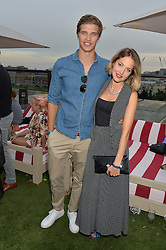 TOBY HUTINGTON-WHITELEY and TESS WARD at the Warner Music Group & GQ Summer Drinks hosted in asociation with Quintessentially at Shoreditch House, Ebor Street, London on 6th July 2016.