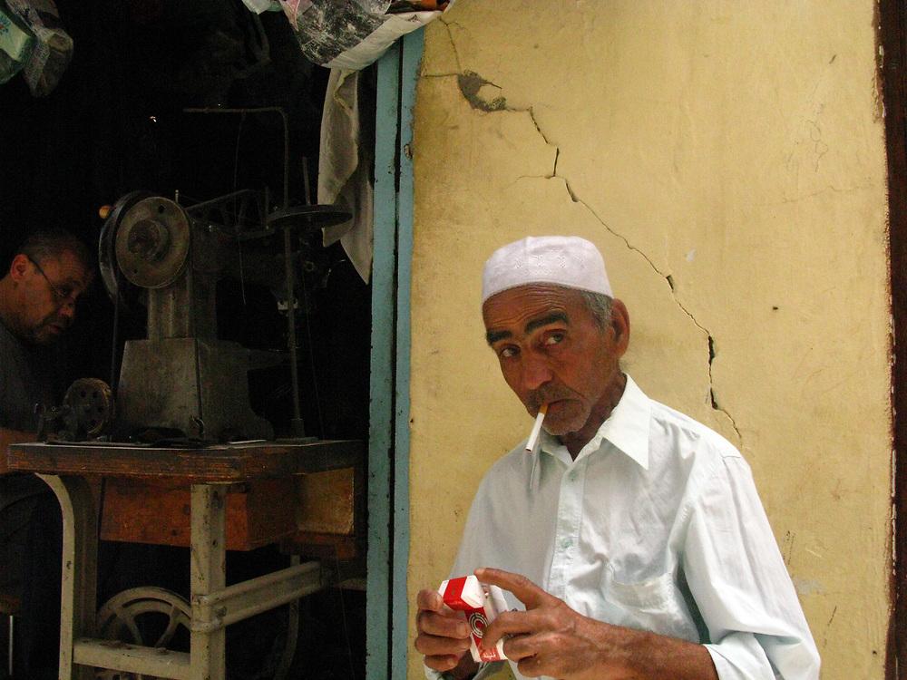 Man in textile souk, Kairouan, Tunisia, 2008