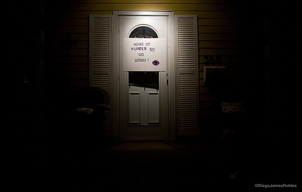 A homemade sign hangs outside senior defensive tackle Taylor McGuire's home on Friday morning, Sept. 26, 2008, in Logan, Ohio.