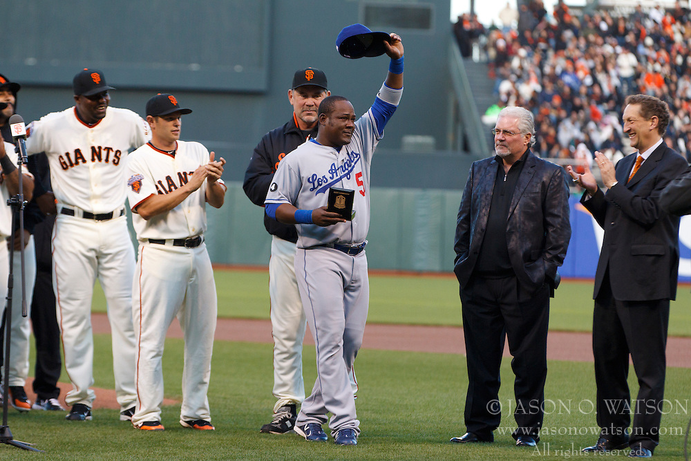 April 11, 2011; San Francisco, CA, USA;  Los Angeles Dodgers second baseman Juan Uribe (5) receives his 2010 World Series championship ring before the game against the San Francisco Giants at AT&T Park.