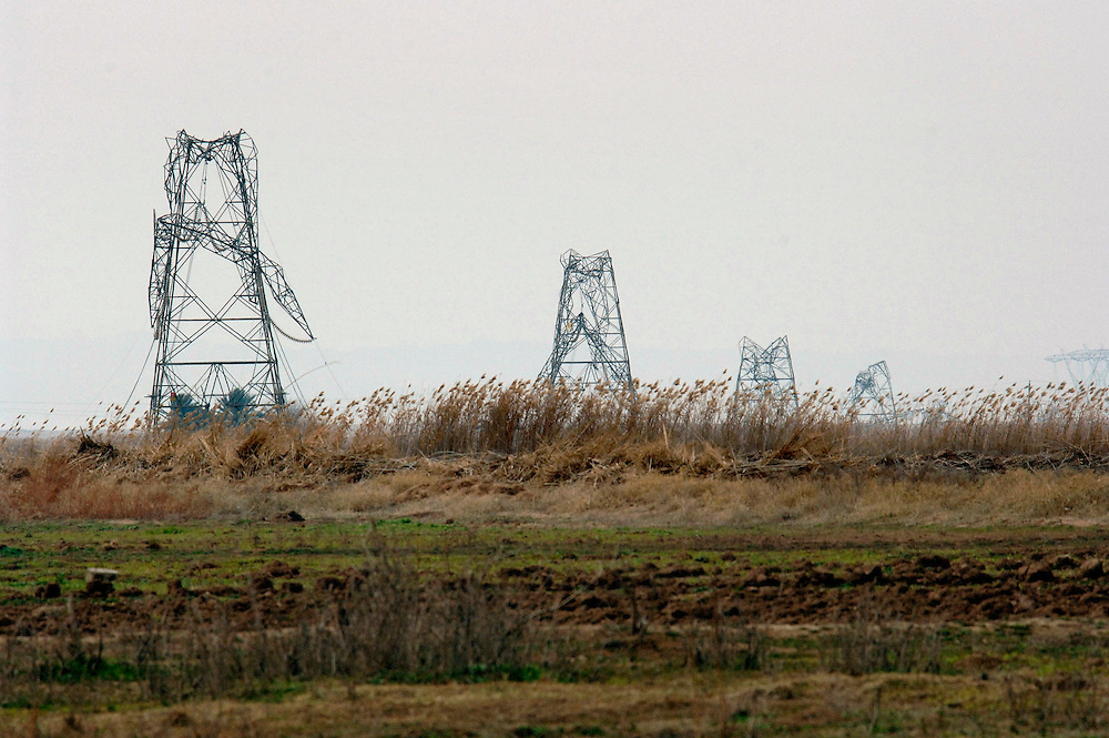 Power transmission towers north of Kirkuk, Iraq. Interdiction is one of the causes for the collapse of many towers in Iraq.  (U.S.. Air Force photo by Lance Cheung)<br />