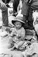 Small Vietnamese boy refugee seen during the evacuation of Xuan Loc in Vietnam. April 1975. Photograph by Terry Fincher