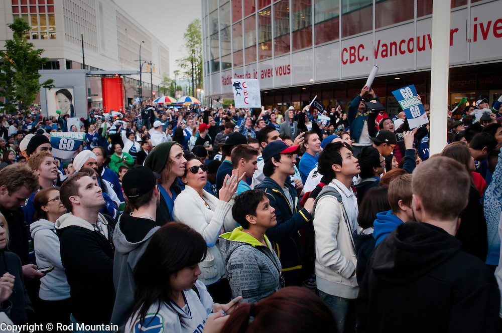 Vancouver, BC, Canada - May 24, 2011 - A crowd gathers outside the CBC studio in Vancouver enjoying a hockey playoff game in May of 2011. The Vancouver Canucks were victorious over the San Jose Sharks 3-2 advancing to the Stanley Cup Final for the first time in 17 long years.<br />