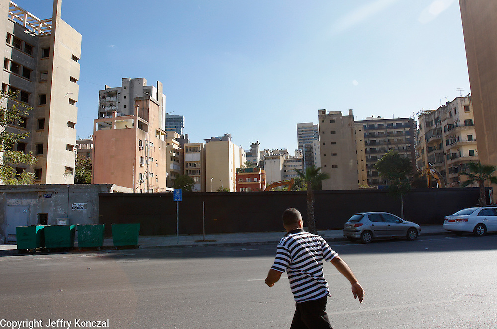 A man walks across the street in Beirut, Lebanon.