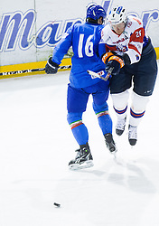 Alexander Egger of Italy vs Jan Urbas of Slovenia during Friendly Ice-hockey match between National teams of Slovenia and Italy on April 5, 2013 in Ice Arena Tabor, Maribor, Slovenia. (Photo By Vid Ponikvar / Sportida)