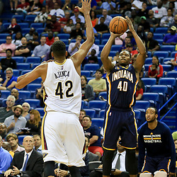 Oct 4, 2016; New Orleans, LA, USA;  Indiana Pacers guard Glenn Robinson III (40) shoots over New Orleans Pelicans center Alexis Ajinca (42) during the second quarter of a game at the Smoothie King Center. Mandatory Credit: Derick E. Hingle-USA TODAY Sports