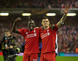 LIVERPOOL, ENGLAND - Thursday, April 14, 2016: Liverpool's goal-scorers Mamadou Sakho and Dejan Lovren celebrate the incredible 4-3 (5-4 aggregate) victory over Borussia Dortmund during the UEFA Europa League Quarter-Final 2nd Leg match at Anfield. (Pic by David Rawcliffe/Propaganda)