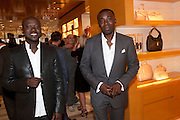 DAVID ADJAYE; CHRIS OFILI, Louis Vuitton openingof New Bond Street Maison. London. 25 May 2010. -DO NOT ARCHIVE-© Copyright Photograph by Dafydd Jones. 248 Clapham Rd. London SW9 0PZ. Tel 0207 820 0771. www.dafjones.com.