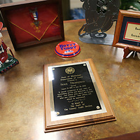 Lauren Wood | Buy at photos.djournal.com<br /> An award honoring County Administrator Sean Thompson sits amongst other memorabilia during the retirement reception held for Thompson Monday afternoon at the Lee County Board of Supervisors building.