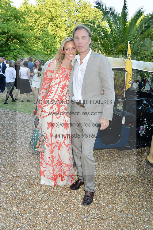 DAMIAN ASPINALL and VICTORIA FISHER at the Quintessentially Foundation and Elephant Family 's 'Travels to My Elephant' Royal Rickshaw Auction presented by Selfridges and hosted by HRH The Prince of Wales and The Duchess of Cornwall held at Lancaster House, Cleveland Row, St.James's, London on 30th June 2015.
