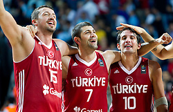 Hidayet Turkoglu of Turkey, Omer Onan of Turkey and Kerem Tunceri of Turkey celebrate during the second semifinal basketball match between National teams of Serbia and Turkey at 2010 FIBA World Championships on September 11, 2010 at the Sinan Erdem Dome in Istanbul, Turkey. Turkey defeated Serbia 83 - 82 and qualified to finals.  (Photo By Vid Ponikvar / Sportida.com)