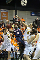 19 March 2010: Caroline Bernal-Silva strips Philana Greene of the ball during a shot. The Flying Dutch of Hope College defeat the Yellowjackets of the University of Rochester in the semi-final round of the Division 3 Women's Basketball Championship by a score of 86-75 at the Shirk Center at Illinois Wesleyan in Bloomington Illinois.