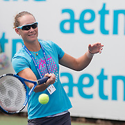 August 16, 2014, New Haven, CT:<br /> Sam Stosur hits a forehand during a tennis clinic in the AETNA FitZone as part of Kids Day on day three of the 2014 Connecticut Open at the Yale University Tennis Center in New Haven, Connecticut Sunday, August 17, 2014.<br /> (Photo by Billie Weiss/Connecticut Open)