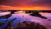 Sunset over the royal fishponds at Hapaiali'i Heiau, Kona Coast, The Big Island, Hawaii USA