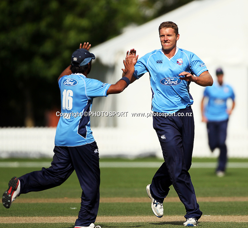 Michael Bates celebrates with Ronald Hira after a wicket. Auckland Aces v Wellington Firebirds, Ford Trophy one day game held at Burt Sutcliffe Oval, Lincoln, Friday 25 November 2011. Photo : Joseph Johnson / photosport.co.nz