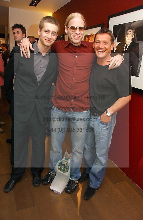 Left to right, TYRONE WOOD, JAMIE WOOD and SID OWEN at an exhibition of photographs by David Montgomery entitled 'Shutterbug' held at Scream, 34 Bruton Street, London W1 on 13th July 2006.<br />