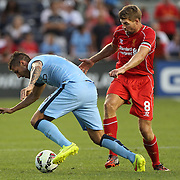 Stevan Jovetic, (left), Manchester City, is challenged by Steven Gerrard, Liverpool, during the Manchester City Vs Liverpool FC Guinness International Champions Cup match at Yankee Stadium, The Bronx, New York, USA. 30th July 2014. Photo Tim Clayton