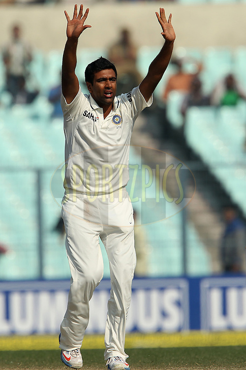 Ravichandran Ashwin of India appeals for the wicket of Monty Panesar of England during day four of the 3rd Airtel Test Match between India and England held at Eden Gardens in Kolkata on the 8th December 2012..Photo by Ron Gaunt/BCCI/SPORTZPICS ..Use of this image is subject to the terms and conditions as outlined by the BCCI. These terms can be found by following this link:..http://www.sportzpics.co.za/image/I0000SoRagM2cIEc