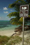Sign informing vistors of turtle nesting beach on a barrier island off Belize.