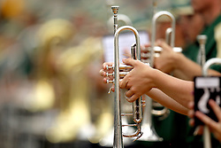 A member of the Baylor University band stands at attention during the NCAA college football game against Baylor and Stephen F. Austin State, Saturday, Sept. 17, 2011, in Waco, Texas.