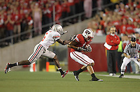 MADISON, WI - OCTOBER 16: Nick Toon #of the Wisconsin Badgers makes a catch against  Chimdi Chekwa #5 of the Ohio State Buckeyes at Camp Randall Stadium on October 16, 2010 in Madison, Wisconsin. Wisconsin defeated Ohio State 31-18. (Photo by Tom Hauck) Player:Nick Toon; Chimdi Chekwa