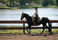 MIDDLETOWN, N.Y. - A young girl rides her horse during the Middletown Rotary Club's 62nd annual Charity Horse Show at the  Rotary Ring in Fancher Davidge Park on Sept. 18, 2005.