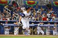 March 12, 2017 - Miami, FL, USA - United States catcher Buster Posey hits a single during the second inning of a World Baseball Classic first round Pool C game against Canada on Sunday, March 12, 2017 at Marlins Park in Miami, Fla. (Credit Image: © David Santiago/TNS via ZUMA Wire)