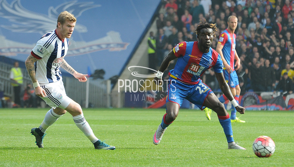 Pape Souare plays a ball out wide during the Barclays Premier League match between Crystal Palace and West Bromwich Albion at Selhurst Park, London, England on 3 October 2015. Photo by Michael Hulf.